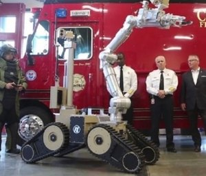 Orlando MayorBuddy Dyerjoined Orlando Fire Department Chief Roderick Williams for a demonstration of their new robot. (Photo/Orlando Sentinel video)
