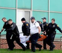 Concern for bleeding victims leads police to shoot gunman