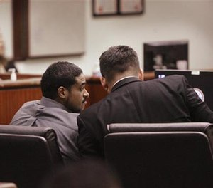 John Hernandez Felix confers with his attorney Michael Rowlands in the Indio Larson Justice Center on Thursday, Oct. 13, 2016 in Indio, Calif. (AP Pool Photo/The Press-Enterprise)