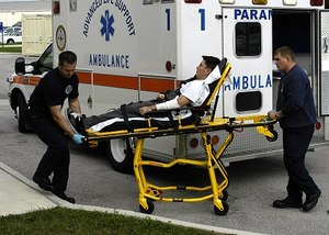 Two paramedics getting ready to lift a patient into an ambulance. (Photo/Wikipedia)