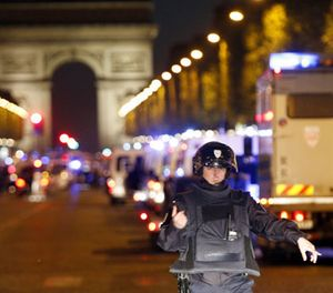 A police officer stands guard after a fatal shooting in which a police officer was killed along with an attacker on the Champs Elysees in Paris, France, Thursday, April 20, 2017. (AP Photo/Thibault Camus)