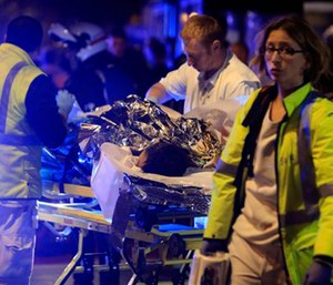 A person is evacuated after a shooting, outside the Bataclan theater in Paris. (AP Photo/Thibault Camus, File)