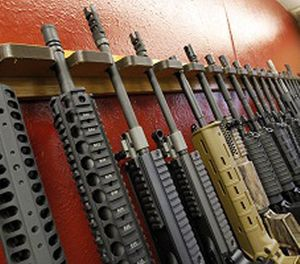 In this July 20, 2012, file photo, a row of different AR-15 style rifles are displayed for sale at the Firing-Line indoor range and gun shop in Aurora, Colo. (AP Photo/Alex Brandon, File)