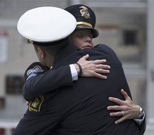 Mourners hug as they arrive at the Cintas Center at Xavier University for the memorial of slain Cincinnati Police Officer Sonny Kim, Thursday, June 25, 2015, in Cincinnati. (AP Image)