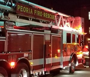 The Peoria City Council voted 8-3 Tuesday to approve eliminating 22 firefighter and 16 police positions as part of a move to close a $6 million budget hole. (Photo/Peoria Public Radio)