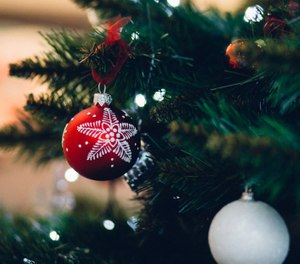 """A letter from Santa starts by acknowledging the traditional delivery date of the 25th, but quickly reminds kids that, as they most likely already know, """"sometimes your mom and dad can't be home on Christmas Day because they're working to keep us safe and healthy."""" (Photo/Pexels)"""