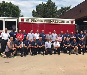 After a lot of comments, complaints and dire warnings, Peoria officials voted in a nonbinding, advisory vote to approve cuts fire and police departments. (Photo/Peoria Fire-Rescue)