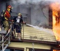 Photo: Firefighter in shorts, tennis shoes battles fire