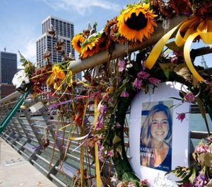 In this July 17, 2015 file photo, flowers and a portrait of Kate Steinle remain at a memorial site on Pier 14 in San Francisco. (Paul Chinn/San Francisco Chronicle via AP, File)