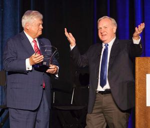 Richard Zuschlag (left) is honored with the Lifetime Achievement Award, presented by Jay Fitch. (Photo/Pinnacle)