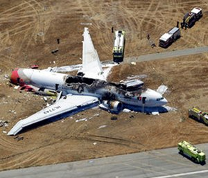 This July 6, 2013, file photo shows the wreckage of Asiana Flight 214 on the ground after it crashed at San Francisco International Airport. (AP Photo/Marcio Jose Sanchez)