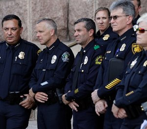 "Houston Police Chief Art Acevedo, from left, Austin Police Chief Brian Manley, Dallas Police Major Rueben Ramirez and San Antonio Police Chief William McManus take part in public safety event where they spoke against a proposed ""bathroom bill,"" Tuesday, July 25, 2017, in Austin, Texas. (AP Photo/Eric Gay)"