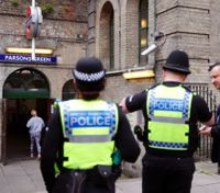UK lowers official terrorist threat level after 2nd arrest