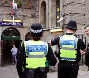 Police forces guard the entrance following Friday's incident on a tube at Parsons Green Station in London, Sunday, Sept. 17, 2017. (AP Photo/Frank Augstein)