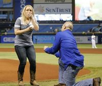Firefighter who saved stabbing victim proposes at Rays game