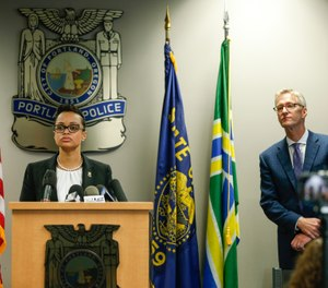 Portland Police Chief Danielle Outlaw and Mayor Ted Wheeler pictured in 2017. (Photo/Stephanie Yao Long/The Oregonian)