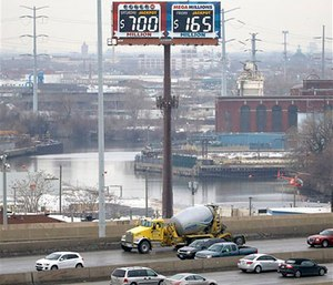 Motorists traveling on the interstate highway near Chicago are reminded by an electronic billboard of the current jackpots for the Powerball and Mega-Millions lotteries. (AP Photo/Charles Rex Arbogast)