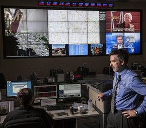 """Jeff Brantingham, anthropology professor at UCLA, displays computer generated """"predictive policing"""" zones at the LAPD Unified Command Post in Los Angeles. (AP Image)"""