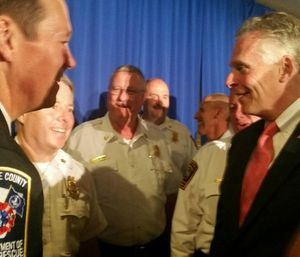 Dan Eggleston, IAFC director-at-large and fire chief of the Albemarle County (Va.) Fire and Rescue, greets Virginia Gov. Terence R. McAuliffe at FirstNet event in Reston, Va. (Photo/IAFC)