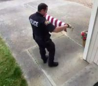 Video: Officer praised after picking up American flag off the ground