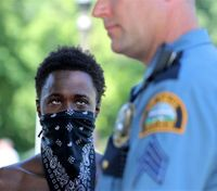 About 70 police protesters arrested at Minn. governor's mansion