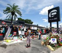 Scores gather outside Pulse nightclub to honor massacre victims