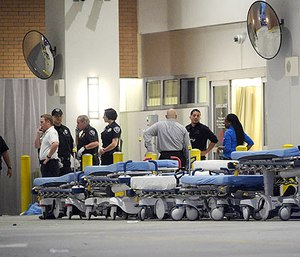 In this June 12, 2016, file photo,emergency personnel wait with stretchers at the emergency entrance to Orlando Regional Medical Center hospital for the arrival of patients from the scene of a fatal shooting at Pulse Orlando nightclub in Orlando, Fla. (AP Photo/Phelan M. Ebenhack, file)