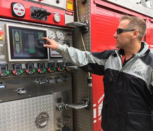 Jason Cerrano, owner and inventor of Phantom Controls, shows the automated screen on the rig that runs the pumps. (Photo/Meera Pal)
