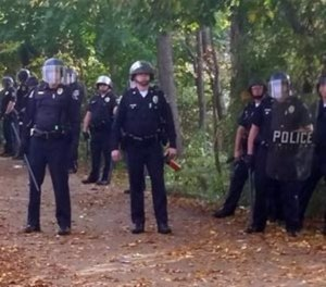 Local police, firefighters and ambulances in New Hampshire responded to large crowds of students as the annual Pumpkin Festival was underway near Keene State College Saturday, Oct. 18, 2014. (AP Image)