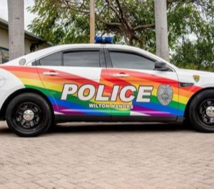 """The Wilton Manors Police Department has redesigned a squad car with a giant rainbow –– a longtime symbol of pride for the LGBT community. A rainbow decorates each side of the car. The back window reads, """"Policing with Pride."""" (Photo/ Wilton Manors Police Department)"""