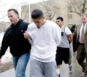 In this Jan. 11, 2018 file photo, suspected members of the MS-13 gang are escorted to their arraignment in Mineola, N.Y. (AP Photo/Seth Wenig, File)
