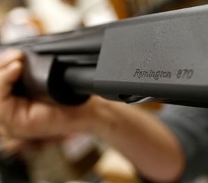 In this March 1, 2018, file photo the Remington name is seen etched on a model 870 shotgun at Duke''s Sport Shop in New Castle, Pa. (AP Photo/Keith Srakocic, File)