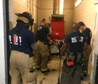 DC firefighters rescue man stuck in trash chute