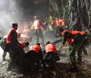 Rescuers work at a tourist site in Zhangzha in Jiuzhaigou county in southwestern China's Sichuan province. (Zheng Lei/Xinhua via AP)