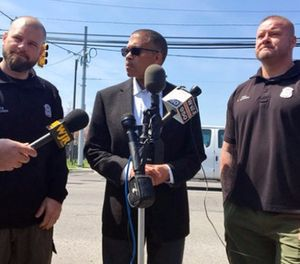 Detroit Police Chief James Craig, center, speaks about Detroit police officers Brian Gadwell, right, and Steven Rauser during a news conference. (Elisha Anderson/Detroit Free Press via AP)