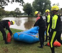 Video: Firefighters rescue woman from SUV trapped in flood