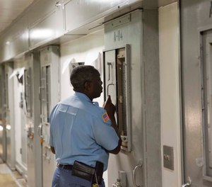 Capt. Dwain Williams checks on a prisoner in the the Special Management Unit, known as high-max at the Georgia Diagnostic and Classification Prison, Tuesday, Dec. 1, 2015, in Jackson, Ga. (AP Photo/David Goldman)