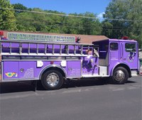 Fire dept. uses purple rig to focus on domestic violence