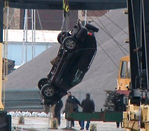 This Jan. 1, 2019 screen shot from WISN-TV shows authorities pulling out an SUV from the Kinnickinnic River, a day after it crashed into the river during a police chase. A toddler, her young mother and a man died when their vehicle drove into a frigid river while being chased by the Milwaukee Police. (WISN-TV via AP)
