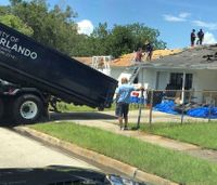 Fla. firefighters repair roof damaged by hurricane