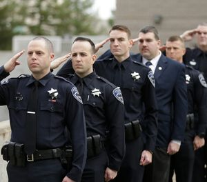 Officers salute before funeral services for Corona at the University of California, Davis, Friday, Jan. 18, 2019, in Davis, Calif. Corona was was shot and killed Jan. 10, responding to scene of a three-car crash in Davis. Police say gunman Kevin Douglas Limbaugh, 48, not involved in the crash, rode up on a bicycle and without warning, opened fire on Corona. (AP Photo/Rich Pedroncelli)