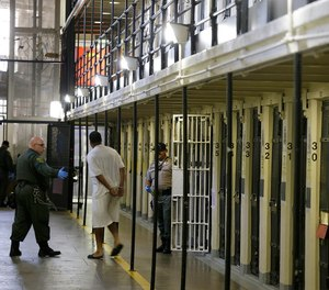 In this Aug. 16, 2016 file photo, a condemned inmate is led out of his east block cell on death row at San Quentin State Prison in San Quentin, Calif. (AP Photo/Eric Risberg, file)