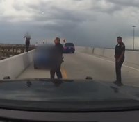 Video: Texas cops rescue woman about to jump from overpass