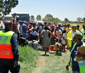 Train passengers are transferred to a bus at the scene of a train accident near Kroonstad, South Africa. (AP Photo)