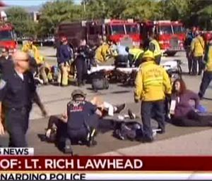 First responders attend to people outside a Southern California social services center in San Bernardino. (KNBC via AP)