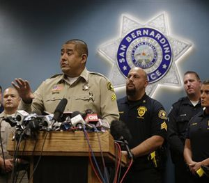 San Bernardino County Sheriff's detective Jorge Lozano, center, answers questions from reporters during a news conference. (AP Image)