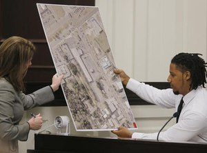 Ninth Circuit Solicitor Scarlett Wilson, left, speaks with Feiden Santana, who made the cell video showing former North Charleston Police Officer Michael Slager's fatal encounter with Walter Scott, as Santana testifies in Slager's murder trial, Friday, Nov. 4, 2016, in Charleston, S.C. (Grace Beahm/Post and Courier via AP Pool)