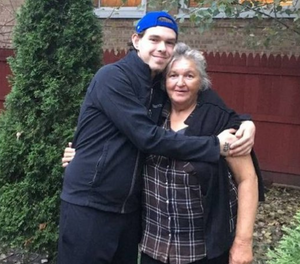 Maria Ursu and her son pose together after police helped them reunite. (Photo/SBPD)