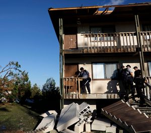 Members of an Indiana urban search and rescue team check an apartment building for residents in the aftermath of hurricane Michael in Callaway, Fla., Thursday, Oct. 11, 2018. (AP Photo/David Goldman)