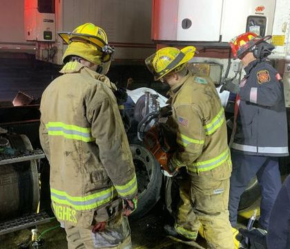 Mich. first responders rescue man trapped between semi tires